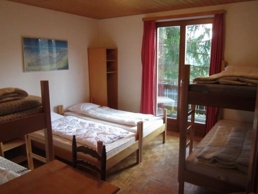 Slaapkamer 1 biedt ruimte aan 6-7 personen